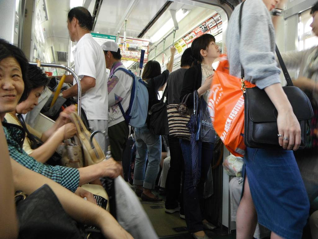 Image result for japan metro old person standing